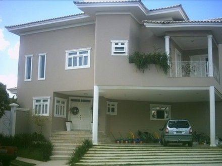 Casas pintadas de marrom e bege externa