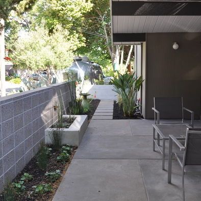 I Pinned This For The Patio Hardscape Not For The Plants Or The Wall Modern Landscaping Concrete Patio Outdoor Design