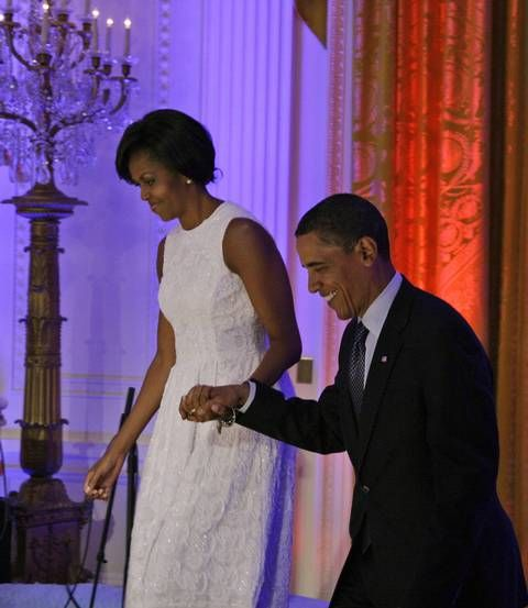 President Barack Obama, enters with his wife Michelle Obama to begin the White House music series celebrating country music in the East Room at the White House, in Washington Tuesday, July 21, 2009. Mrs. Obama sported a faux bob that made some wonder if she had cut her hair.