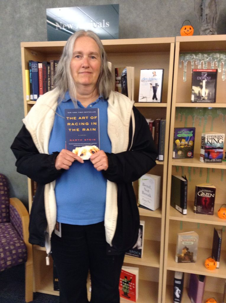"""Deb Rich with her choice of book for winning the """"Check out a Banned Book"""" contest."""