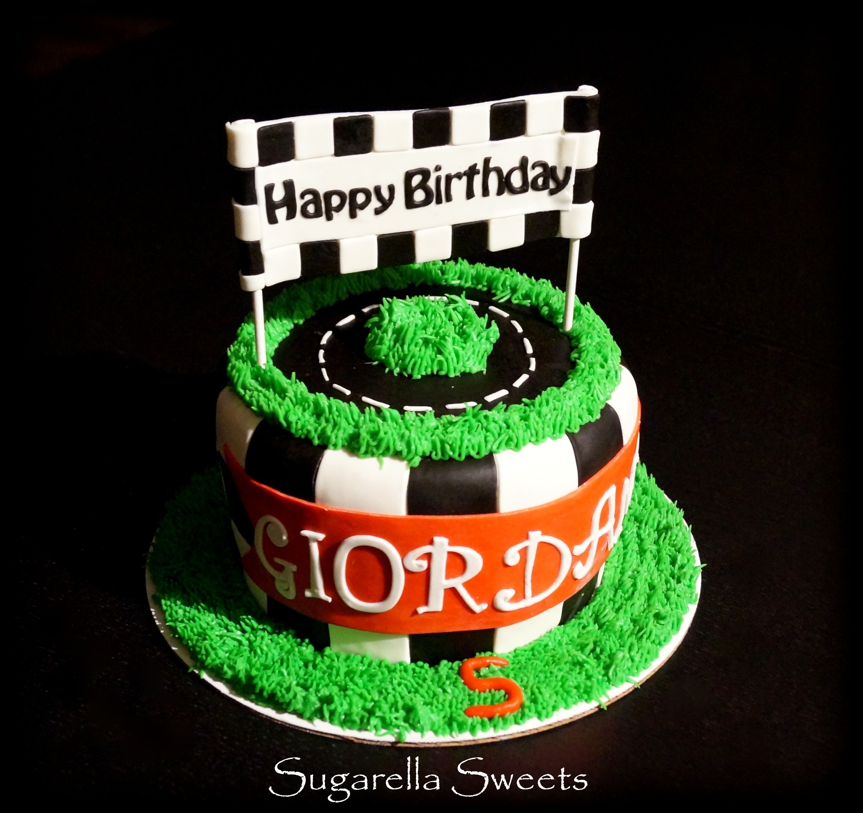 Beautiful race car cake with happy birthday topper race