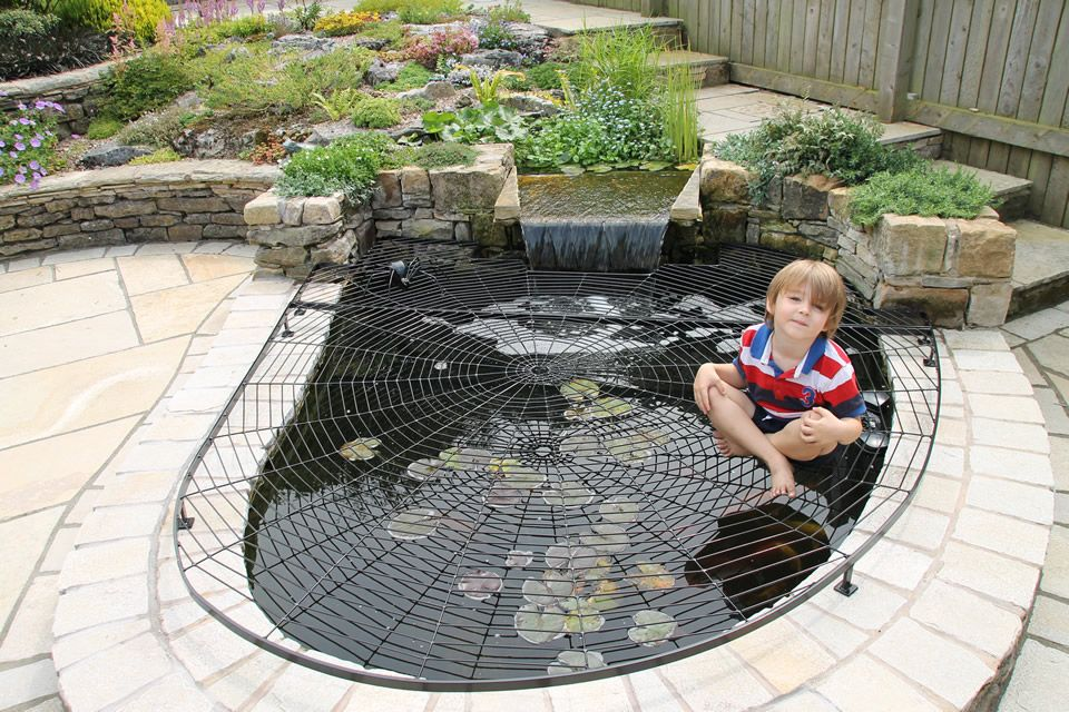This spiderweb design was created for a couple in the lake for Koi pond cover