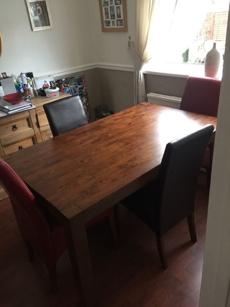 Dining room table and 9 chairs £9 Two red chairs and two dark ...