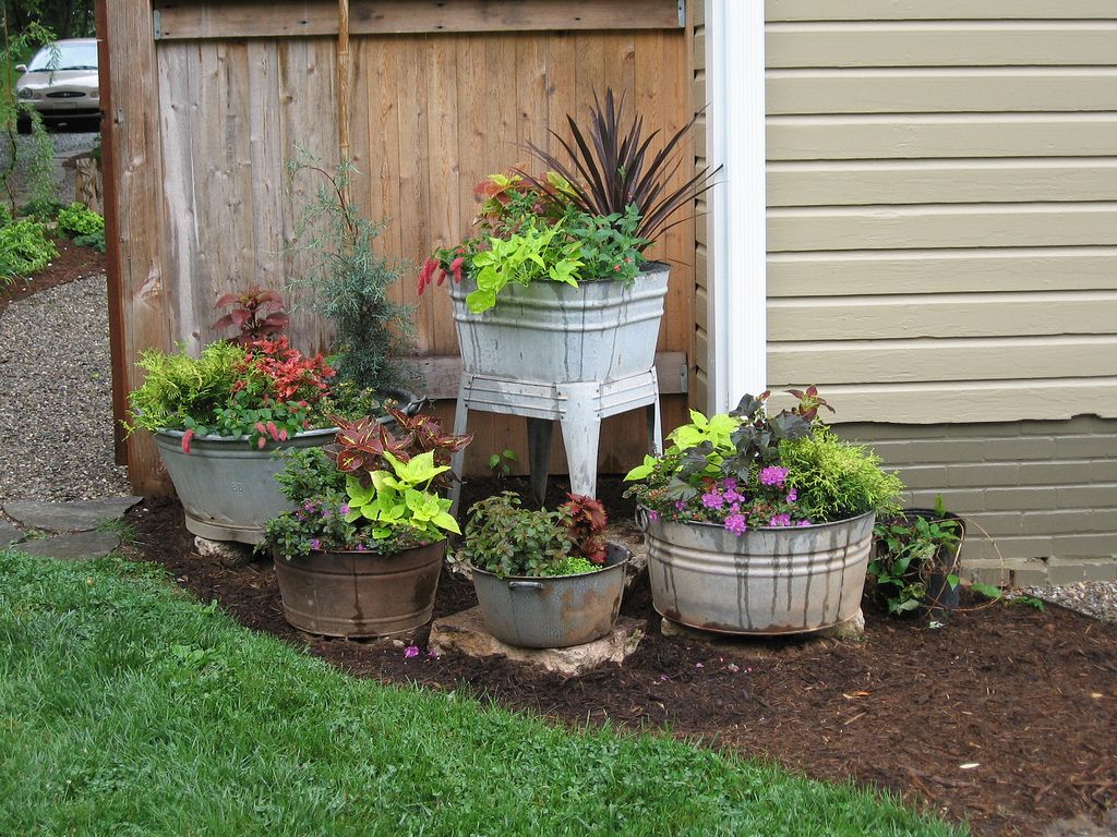 vintage container gardens very cool ideas as i have plenty odd containers to fill like