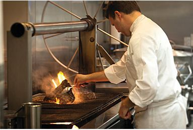 The wood fire grill and smoker can be seen by the guests through our open kitchen