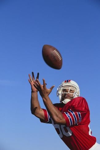 size: 24x16in Photographic Print: Football Player Catching a Football by DLILLC : Entertainment