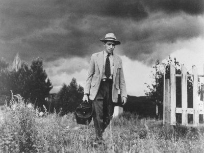 Country Doctor Ernest Ceriani Making House Call On Foot In Small