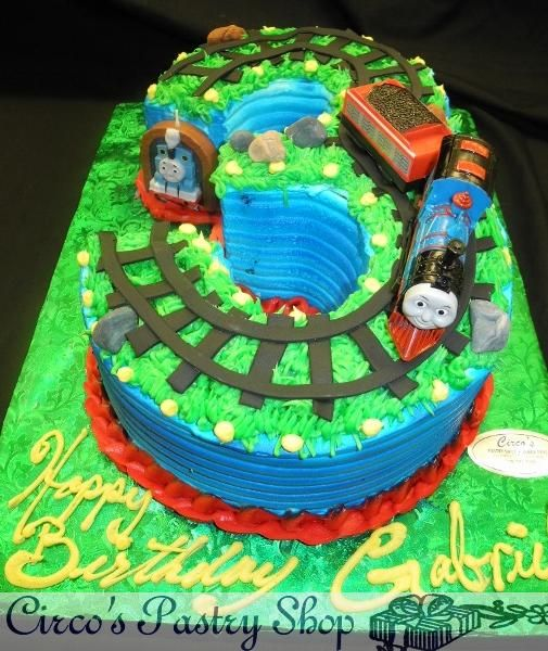 Number 3 Birthday Cake Shape Decorated With Whip Cream And Thomas The Train Decoration