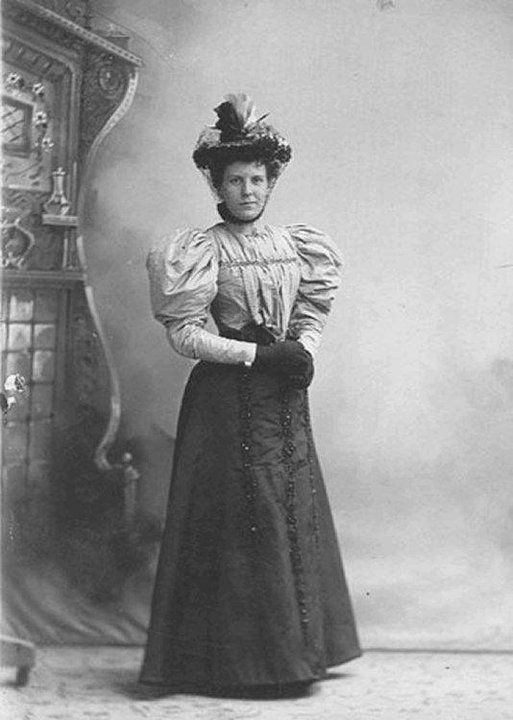 1890s cabinet card, full puffy sleeves, pleated bodice, beaded trim rows down front of skirt, ribbons or feathers sticking straight up on straw hat