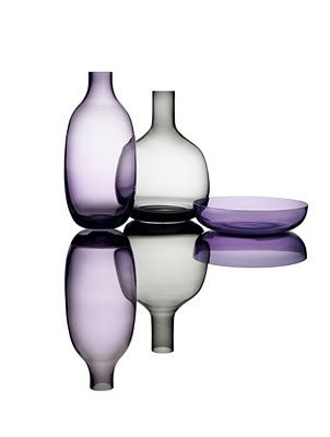 """Simplicity Glasswork by Cecilie Manz  Series of mouth-blown glass for Holmegaard A/S.  """"The name Simplicity refers to the simple and aesthetic shapes.""""  The sculptured pieces are created in transparent glass in the colors smoke and purple, which truly enhance the expression of their beautiful silhouettes."""