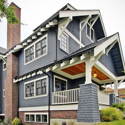 Navy Blue House Exterior With Red Brick And Partly Painted Brick House Exterior Blue Exterior Paint Colors For House Exterior House Colors