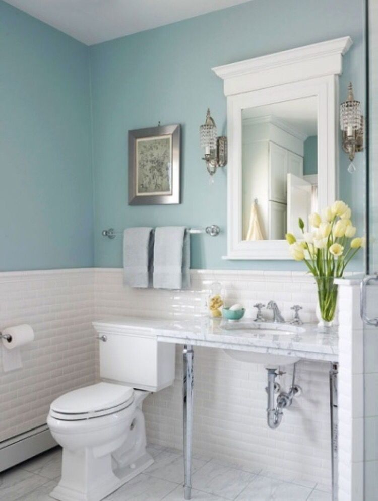 Pale Blue Bathroom With Yellow Accessories