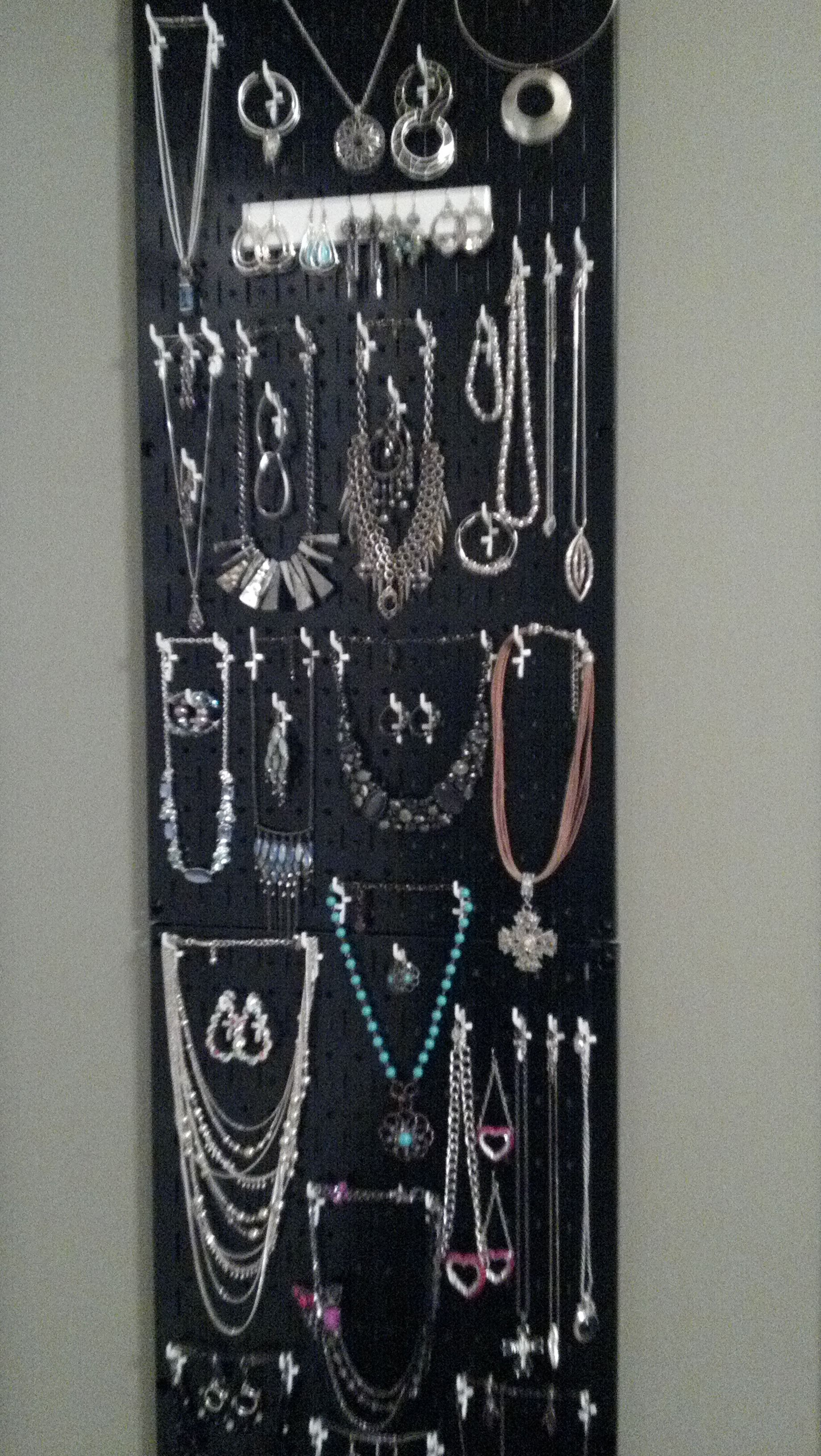 My metal pegboard jewelry organizer behind the door and utilizing a