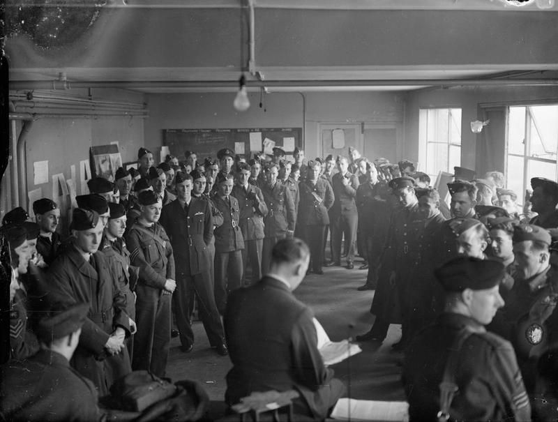 The Commanding Officer of No. 149 Squadron RAF talks to his aircrews in their Operations Room at Mildenhall, Suffolk, before they are briefed for the night's raid.