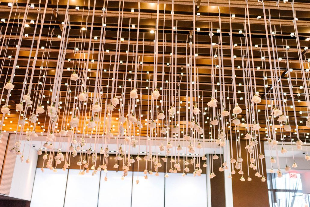 Romantic Suspended White Roses Wedding Reception Decor riverpark New York Wedding Floral Decor by Bride & Blossom Photo by Trent Bailey