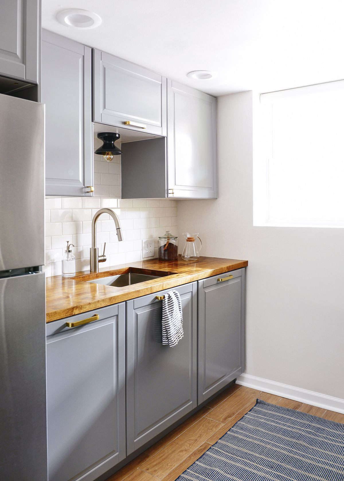 An IKEA galley kitchen by Yellow Brick Home sponsor