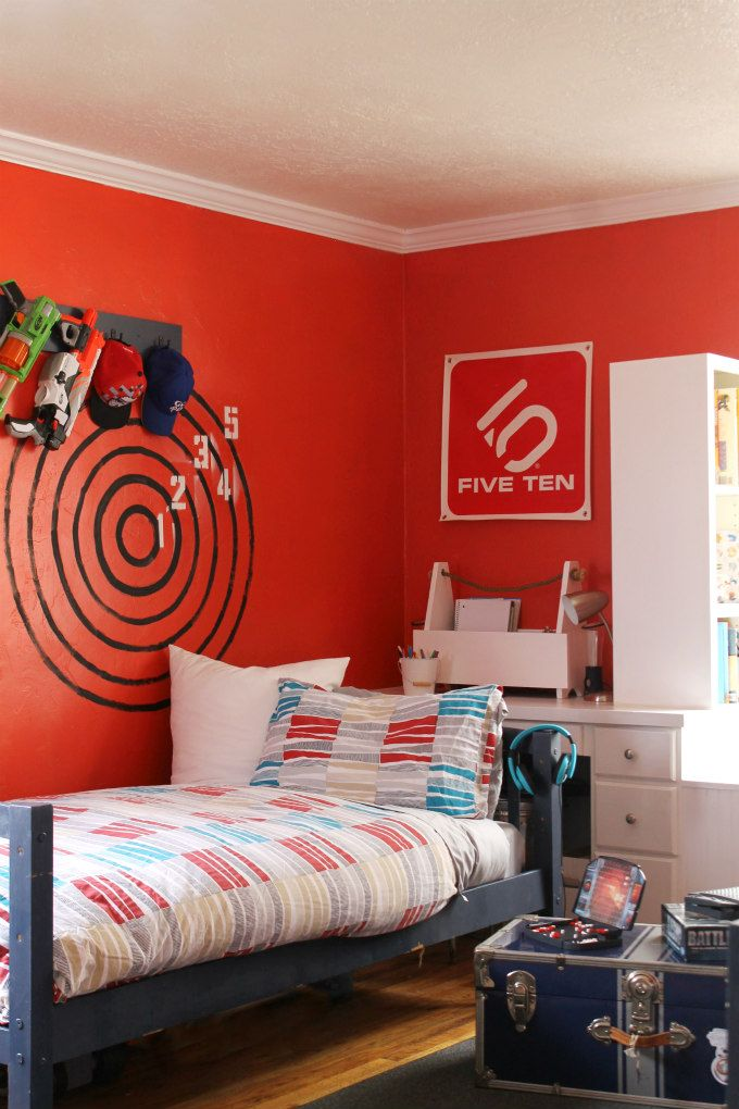 Boys Bedroom With Red Orange Walls And Nerf Target On Wall