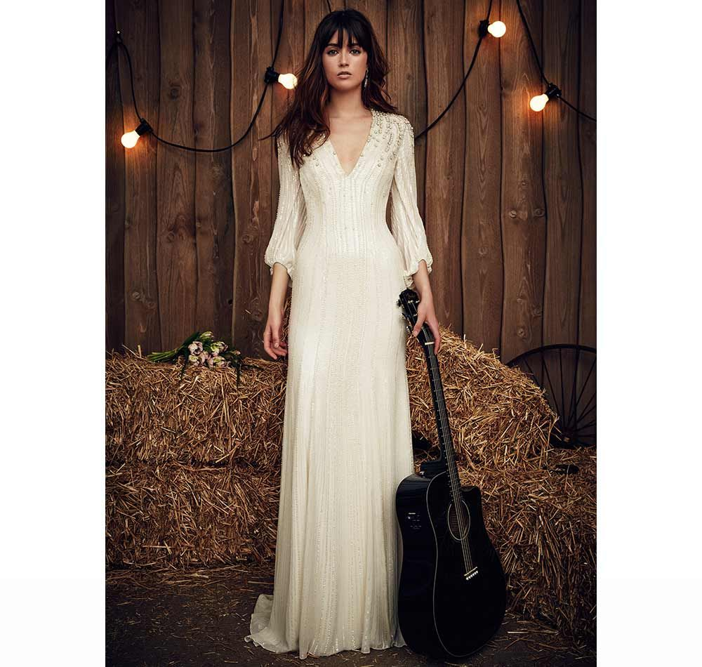 Modest brides will fall head over heels in love with this Jenny Packham design. The feminine neckline is beautifully executed and the detail that vertically runs down the entirety of the dress is beyond amazing. The sleeve detail gives the whole dress a boho look that works so well.