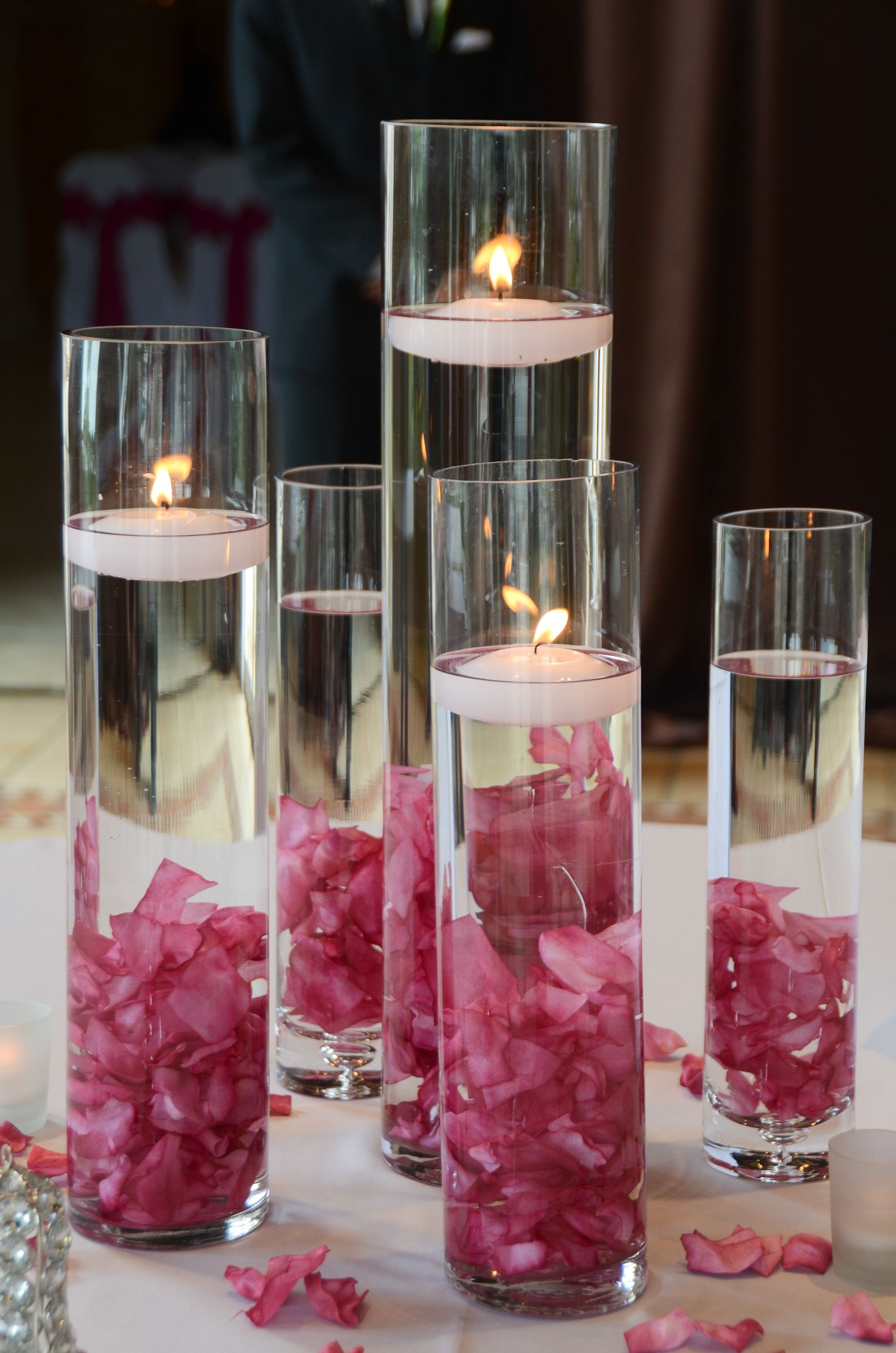 tall cylinder with floating candles and flowers wedding rh pinterest com
