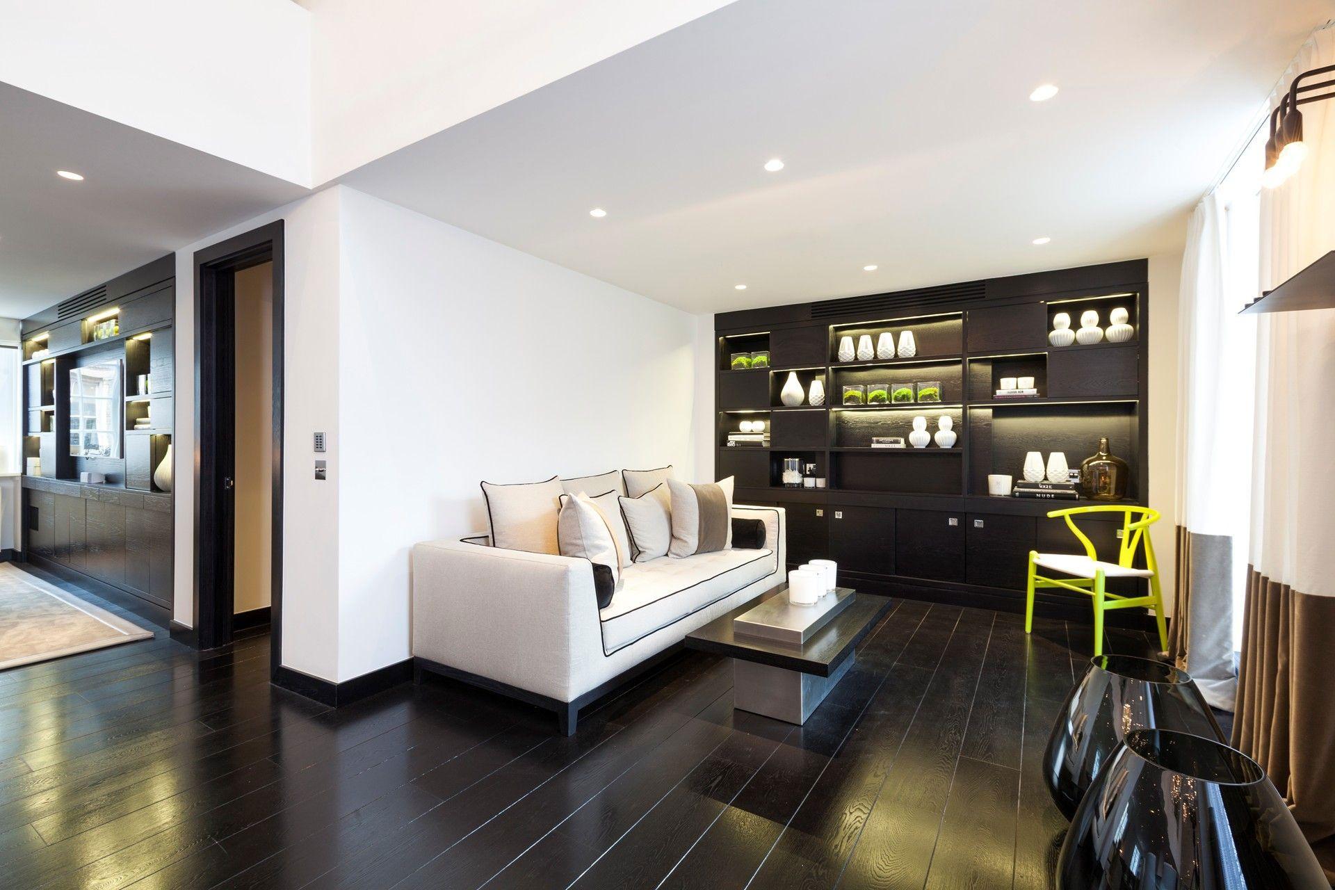 Sofa dark wood flooring living space henrietta street apartment apartment interior design