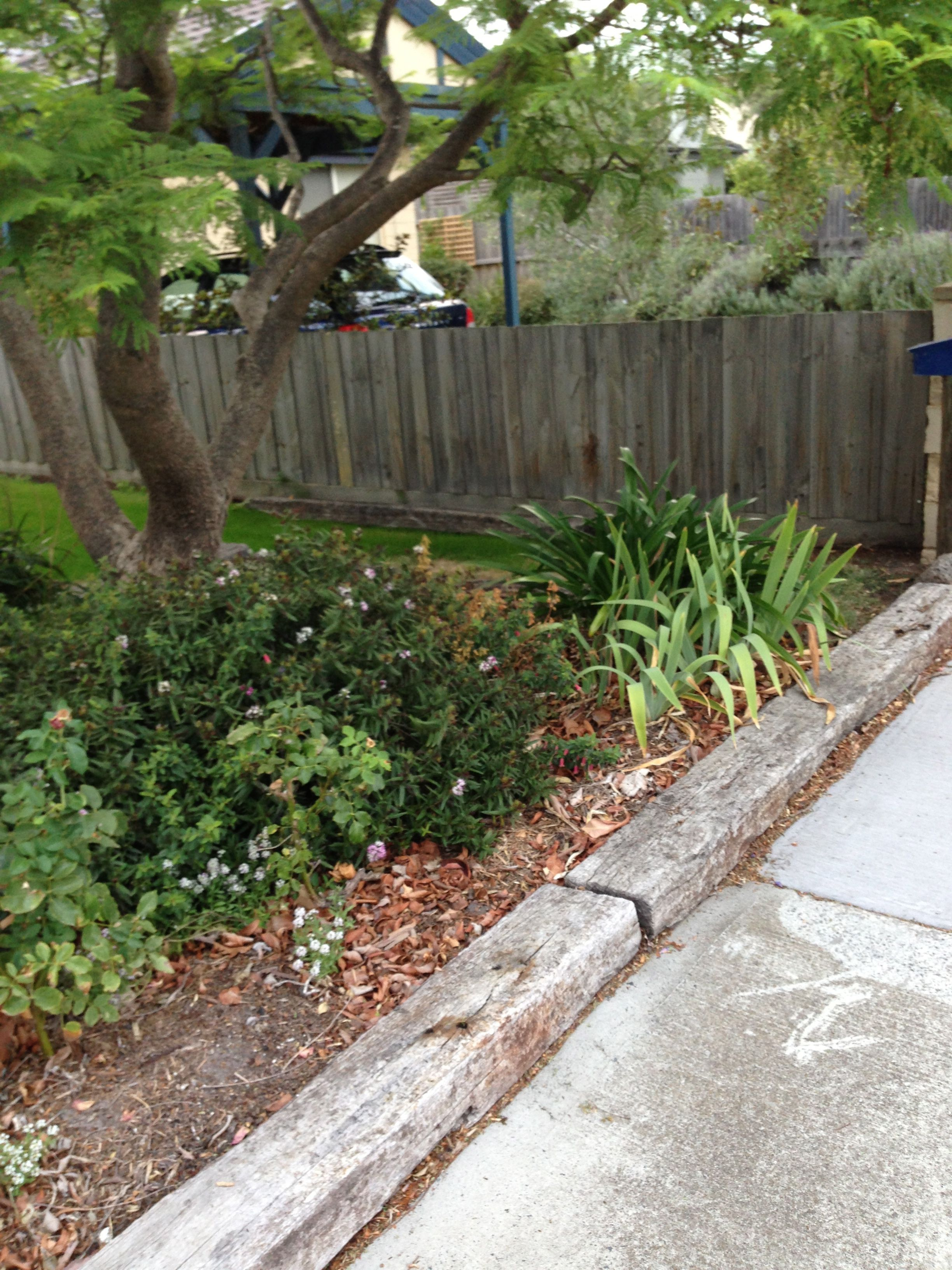 "Garden Ideas Railway Sleepers possibly old railway sleepers? forming a ""fence"" and demarking a"