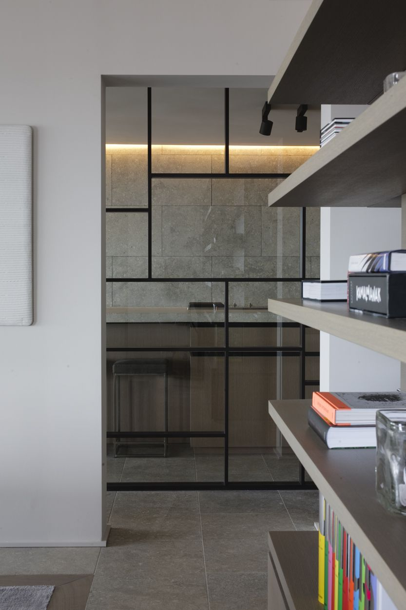Great glass and steel divider wall idea use to separate kitchen