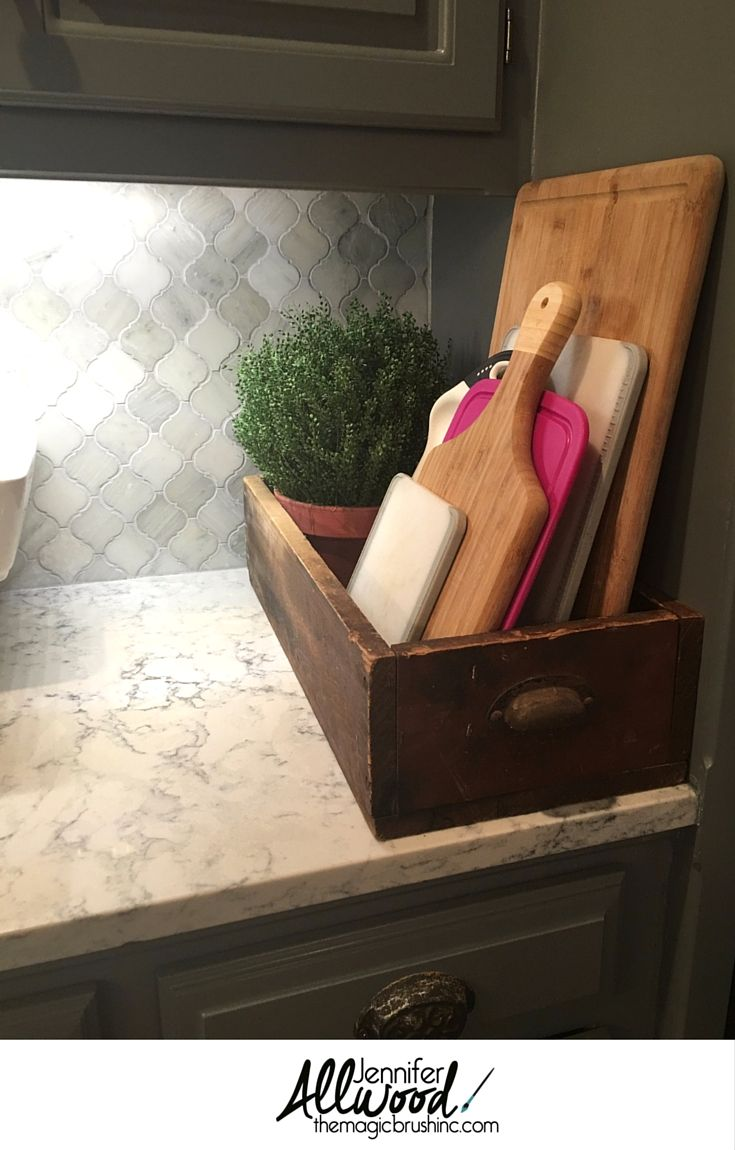 Kitchen Storage Idea for cutting boards -- Stack them in a vintage dresser drawer for a farmhouse feel! Wonderful repurposed kitchen organization idea. More Design Tips and Kitchen Decorating Advice at theMagicBrushinc.com