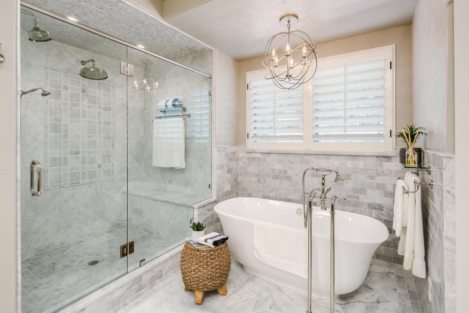 Marble In Soft Gray And White Tones Abounds In This Luxurious Bathroom Carrying Into The Glass Enclosed Show Spa Like Bathroom Bathtub Remodel Marble Bathroom