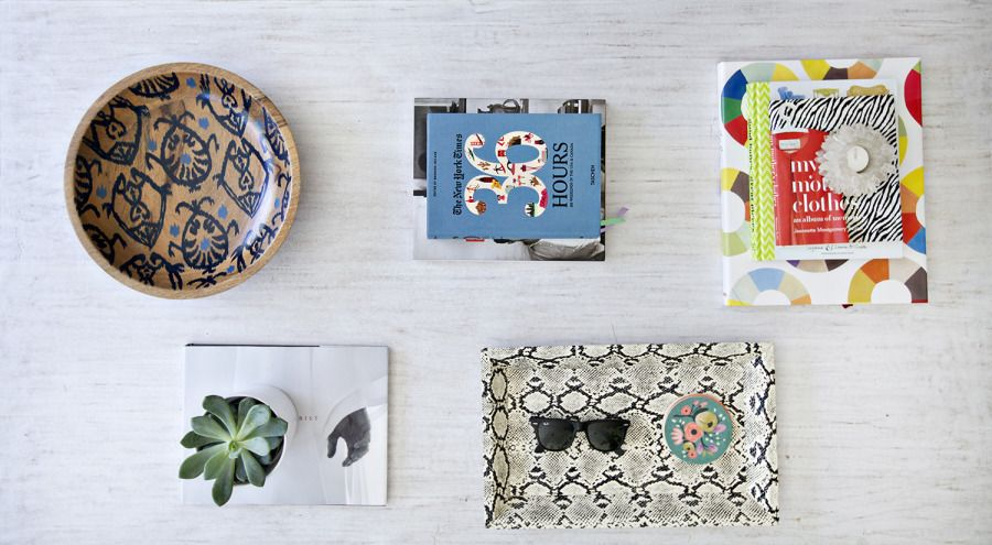 Tiny trays: http://www.stylemepretty.com/living/2014/02/12/how-to-style-your-coffee-table/