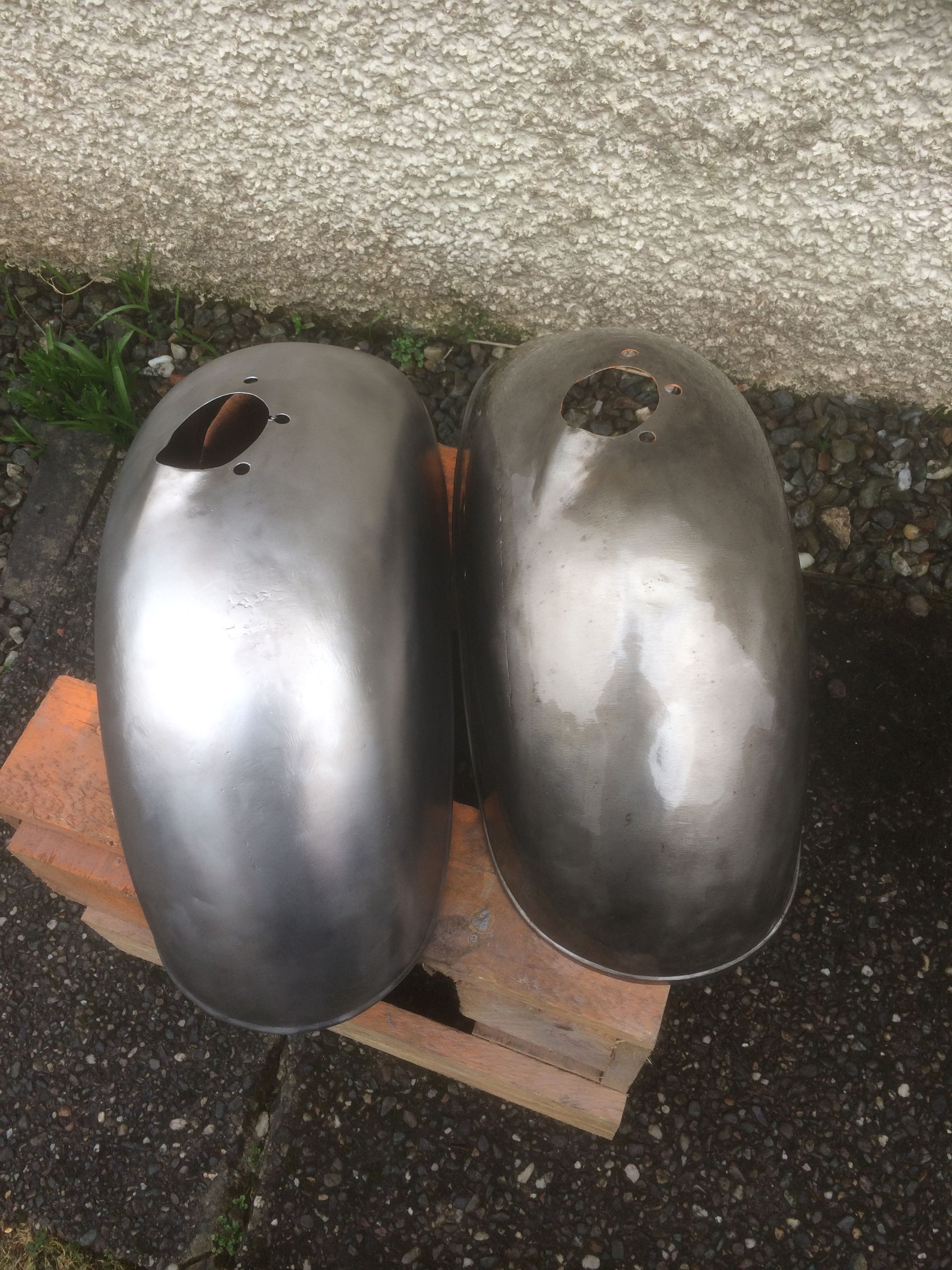 The Mudguard On The Left Is Bare Metal The Mudguard On The Right Has Had The Clear Powder Coat