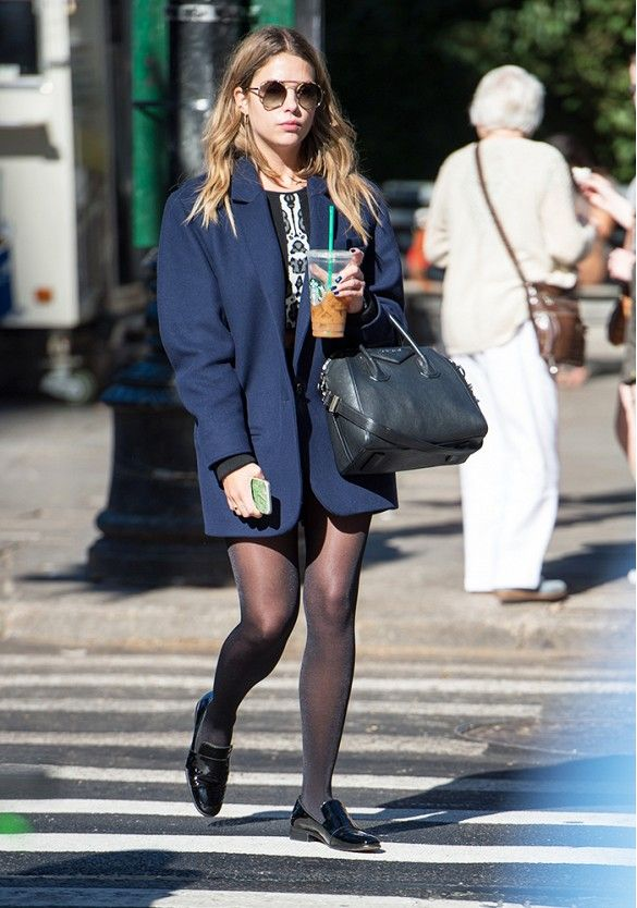 164801d4492 Ashley Benson pairs a short skirt with opaque tights