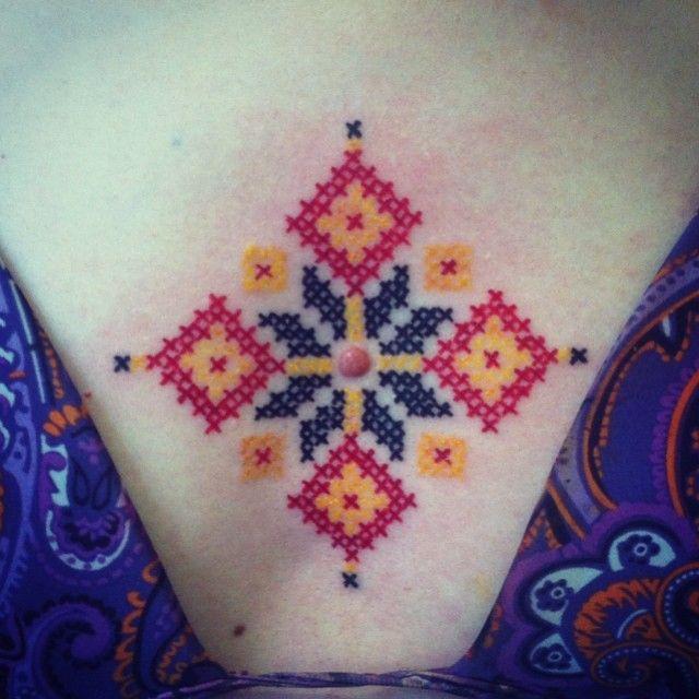 ornamental cross stich tattoo done by Dorin Constantinescu at Old Bastards Tatoo in Cluj, Romania.