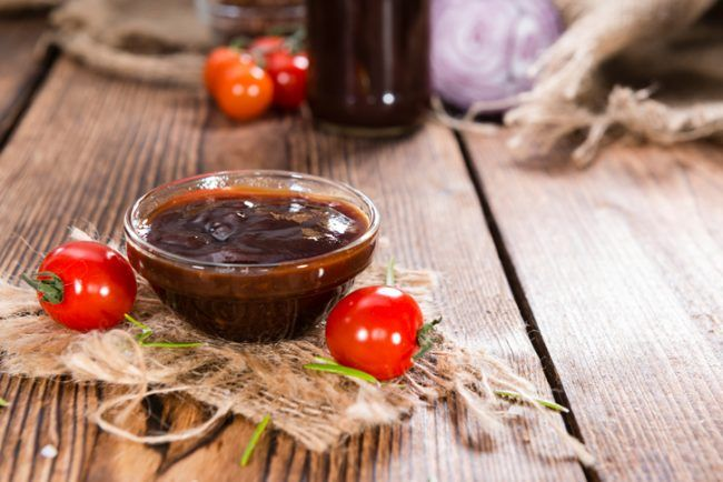 glass bowl of homemade honey bbq sauce on wood  vitacost