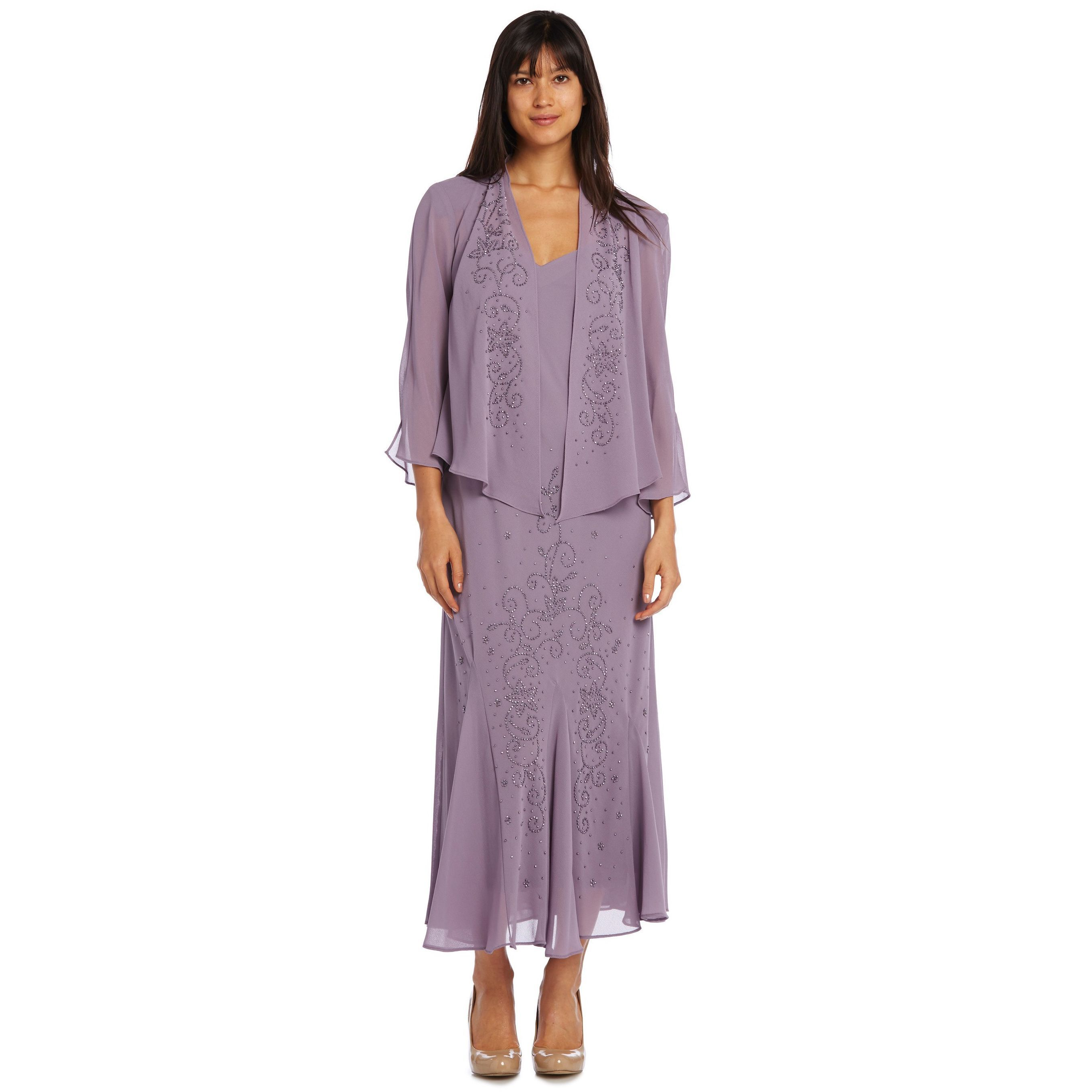 A three quarter sleeved jacket adorns a sleeveless dress in orchid