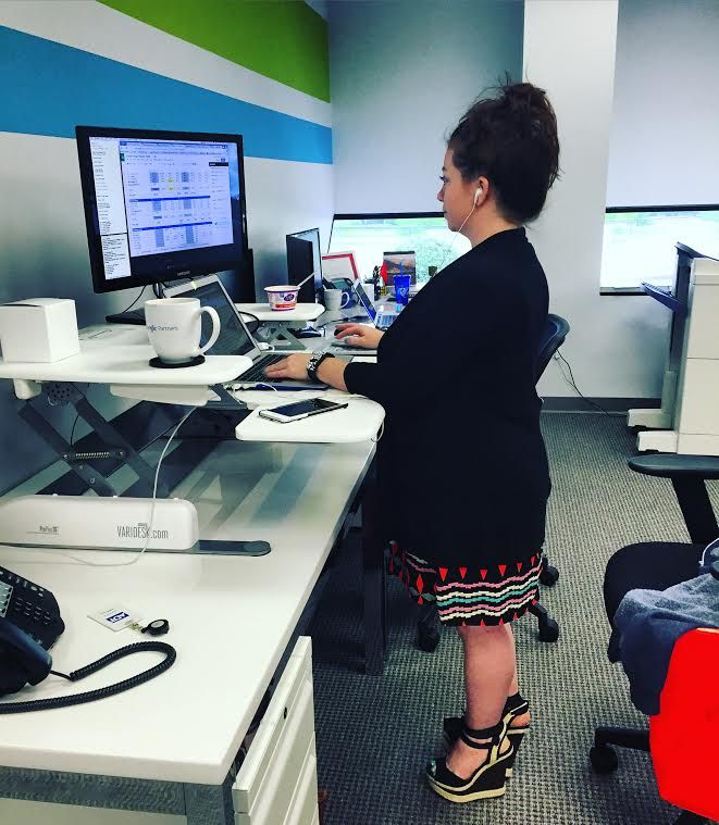 Heather's off to a productive start this #Monday thanks to her new #standingdesk! #healthyoffice