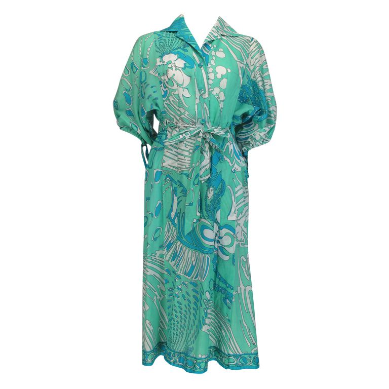 Emilio Pucci cotton batiste shirt dress   Italy, 1960's   Button front dress with dolman sleeves that tie at the cuff. It has a gathered band at the waist back with attached ties that close in the front. Skirt is slightly A-line in shape