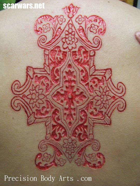 A cutting scarification on my friend Sam. This site is also just amazing for scarifications.