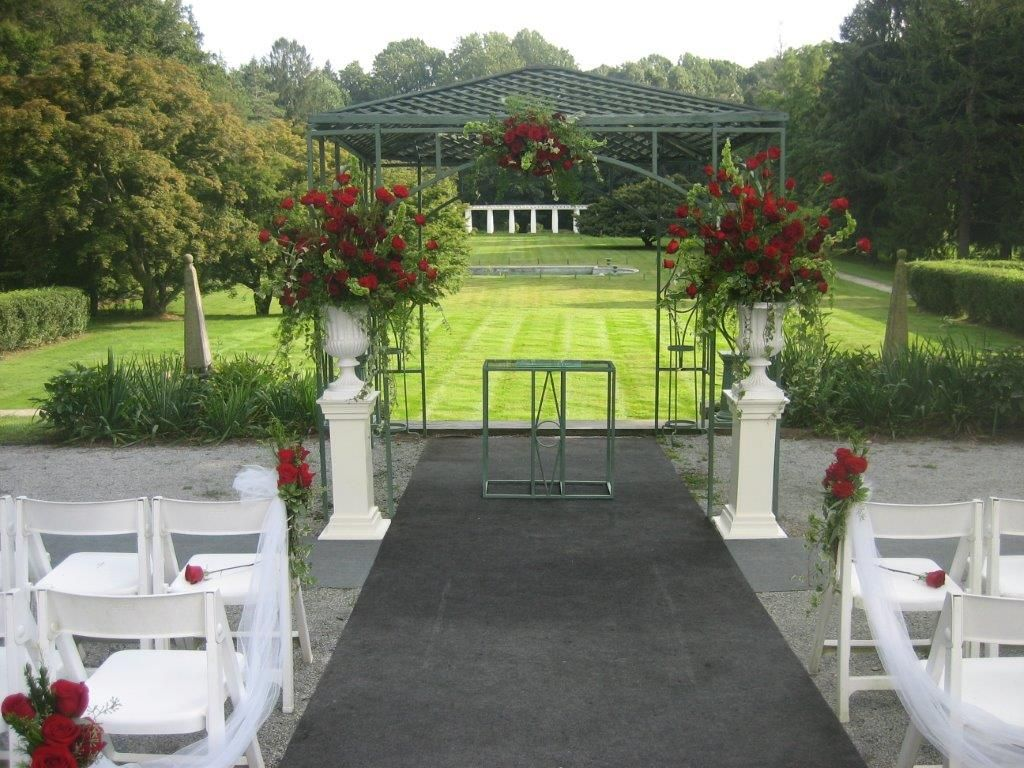 """A striking focal point of opulent red roses for Olga & Louis to say 'I Do"""" at Greystone Hall."""