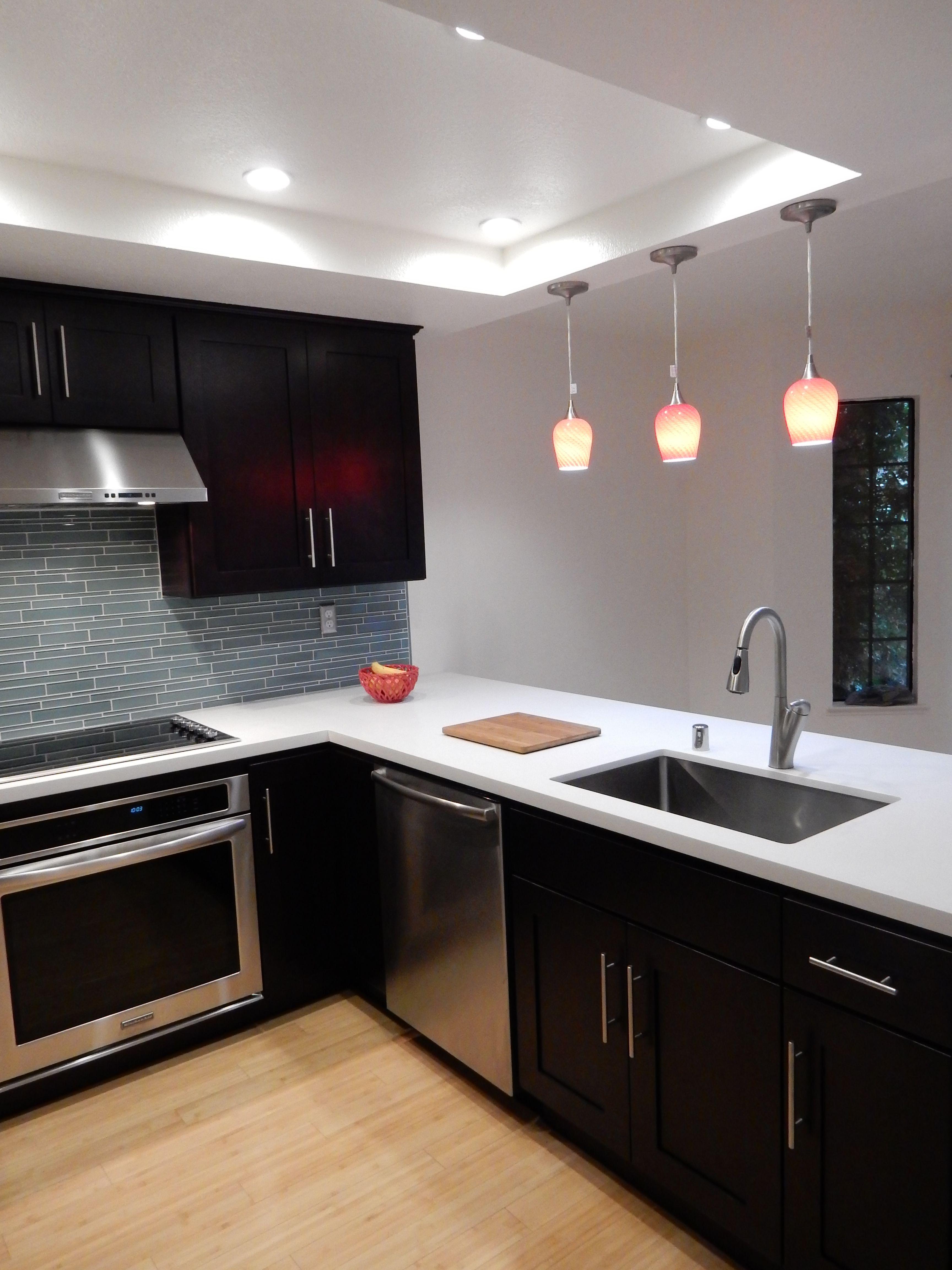 Espresso cabinets  White quartz countertops  Glass back