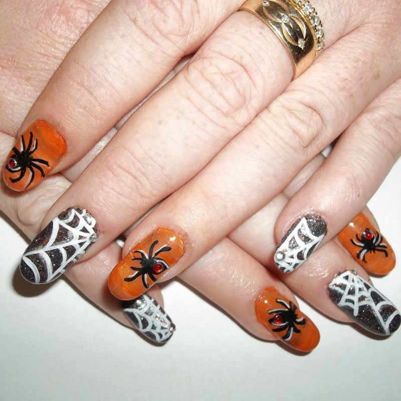This video shows an intricate nail art with cobwebs and spider ...