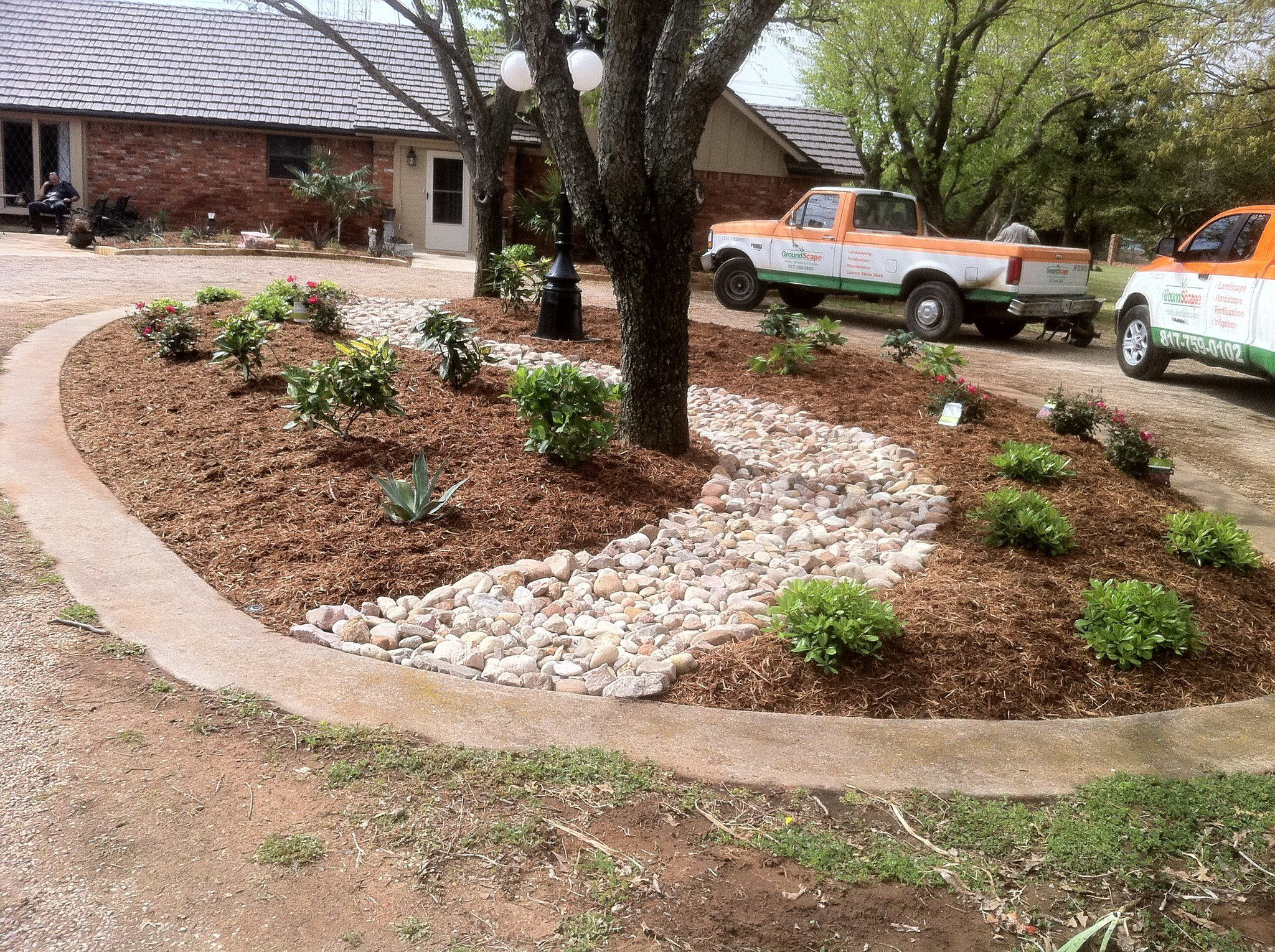 Groundscape A Fort Worth Landscape Company Installs Plants And A Drainage Channel Through A Circle Dr Circle Driveway Landscaping Landscape Design Front Yard