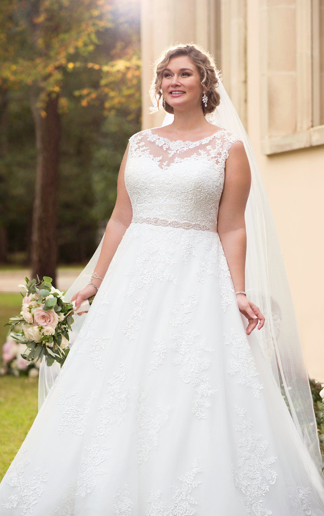 Lace dress wedding  This traditional ball gown plus size wedding dress from Stella York