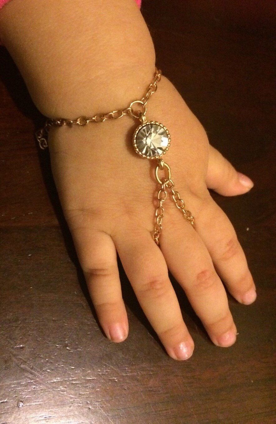 3ed9f04bed Baby girl crystal slave Bracelet or Hand Harness with Finger or Ring, Gold  color with