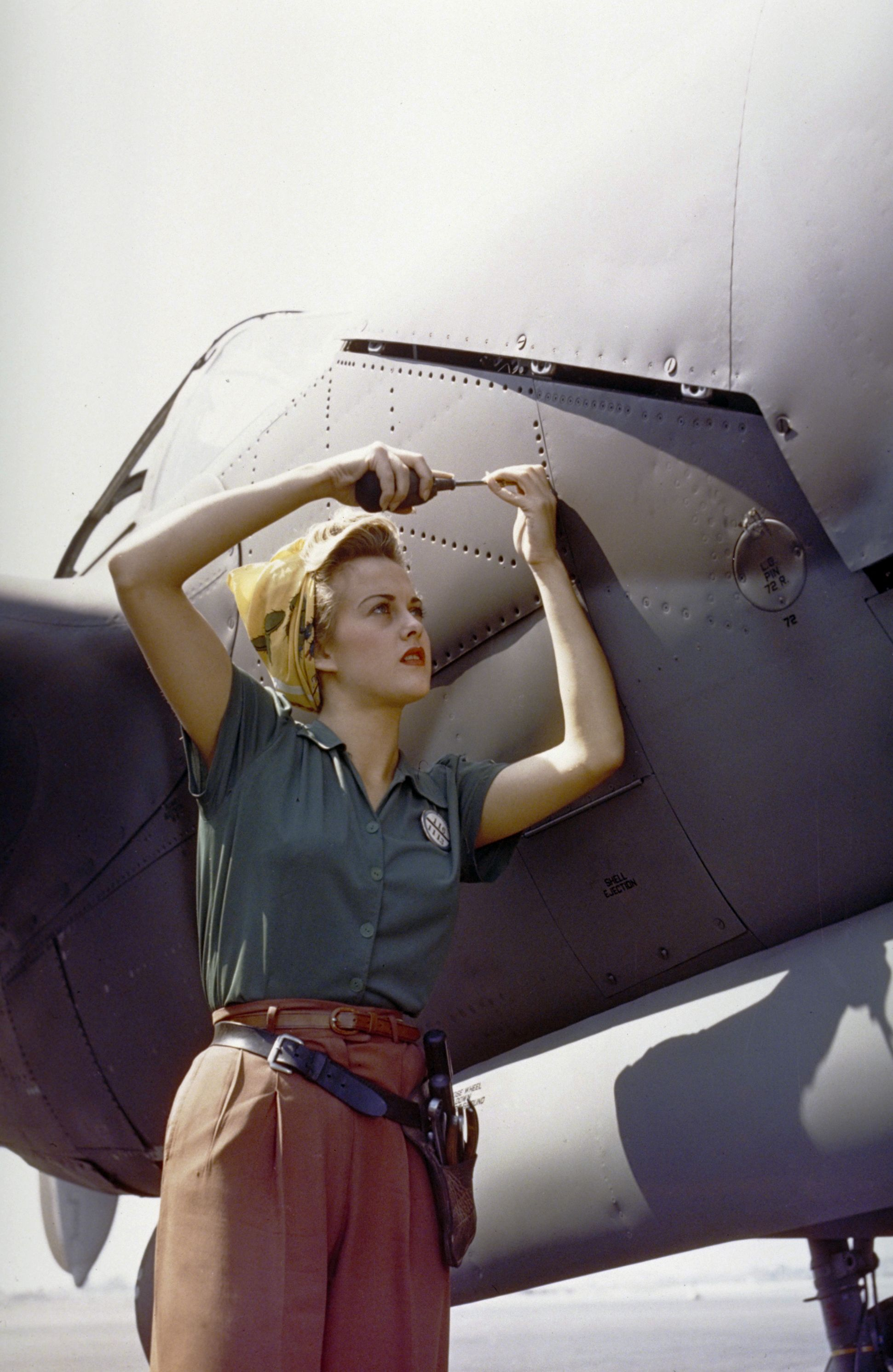 The P-38 Lightning, was first produced in 1941. A Lockheed employee works on one in Burbank, California, 1944.