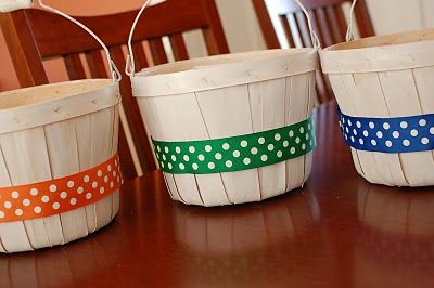 Easter baskets from fruit baskets: I absolutely loved this idea, so I had to make them! I bought 3 fruit baskets from Hobby Lobby for $5.99 each. I spray painted each white. Instead of ribbon, I lined the basket with fabric (I just winged it...no pattern). I tied bows to each handle for my girls. They came out SO flippin' CUTE!! I LOVE them!