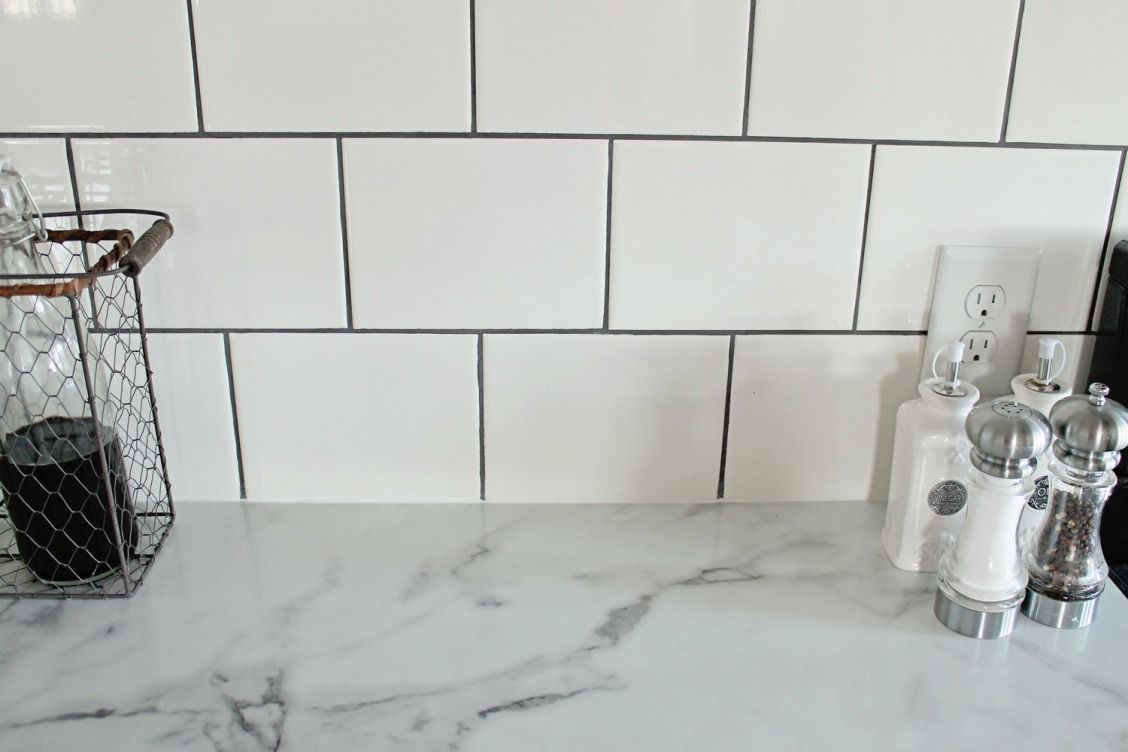 Why we chose love our formica countertops sherwin williams a budget friendly farmhouse renovation by elizabeth burns design featuring white shaker cabinets by formica group 3460 calacatta marble counters subway dailygadgetfo Images
