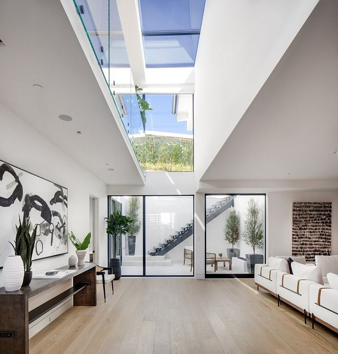 Basement skylight? How could it be possible? The skylight is actually located on the upper level of the home but the open staircase allows it to be seen from the basement. Ingeniously designed #basement #skylight #architecture