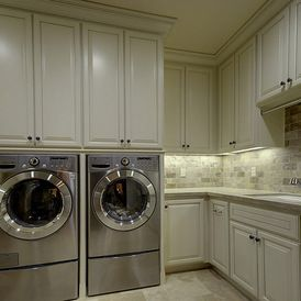 Mediterranean Laundry Room by Lee Construction
