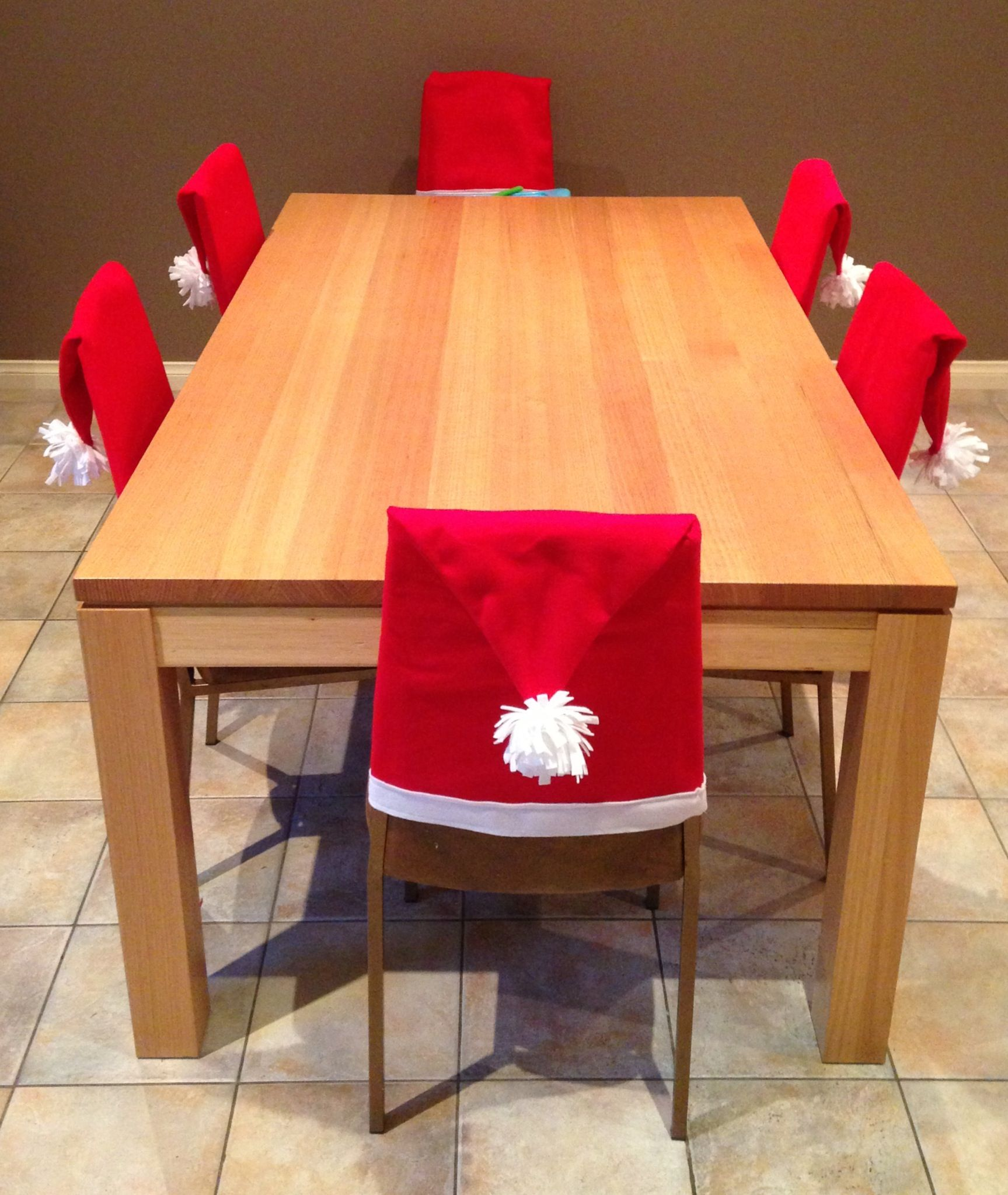 I love Christmas so much and these Santa hat chair covers