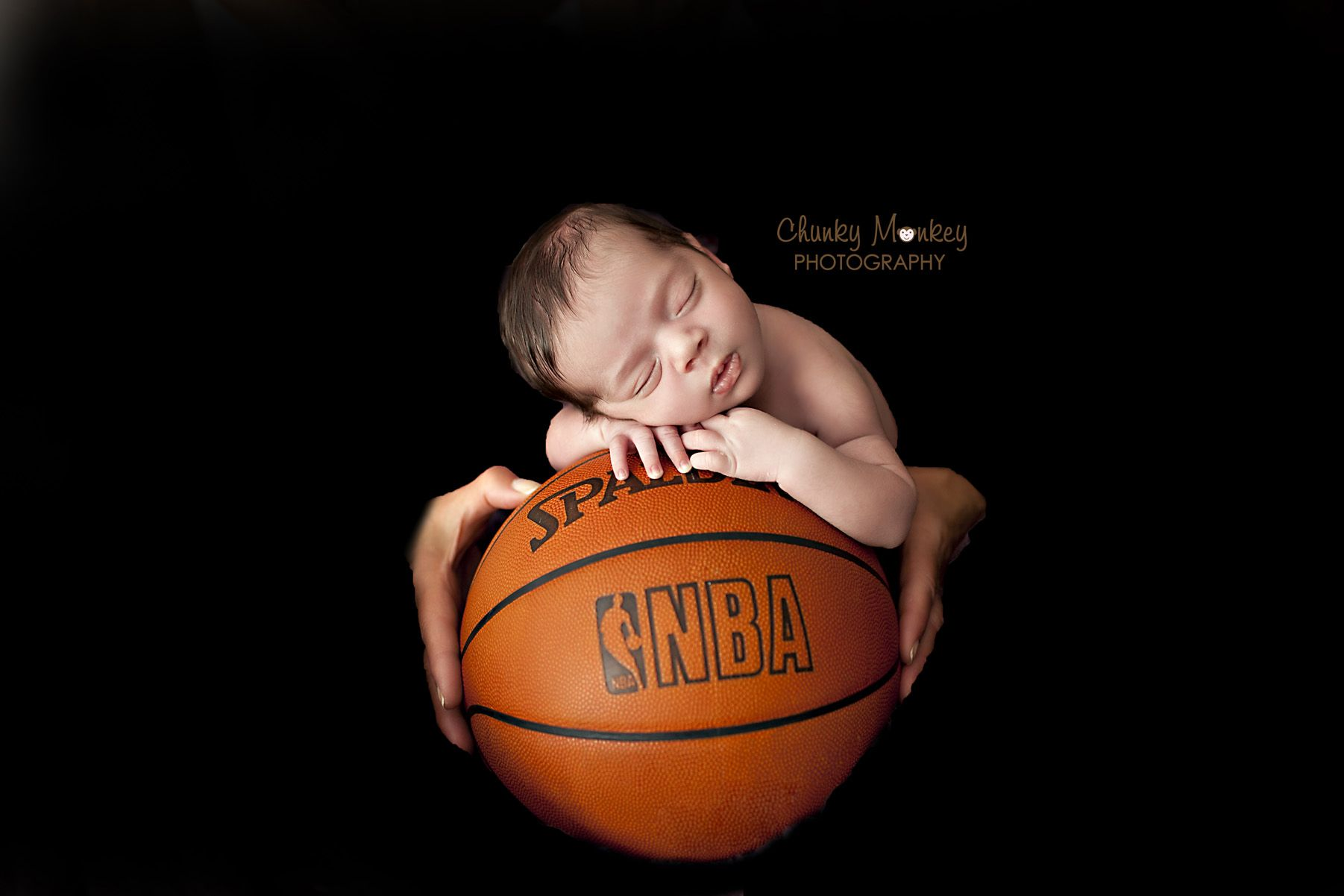 Newborn Photography In A Basketball